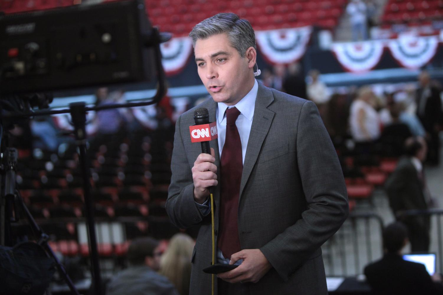Jim Acosta speaks at a campaign rally for Donald Trump at the South Point Arena in Las Vegas, Nevada, on Feb. 22, 2016. Columnist Joe argues CNN and Trump depend on one another to gain more attention from the public eye.