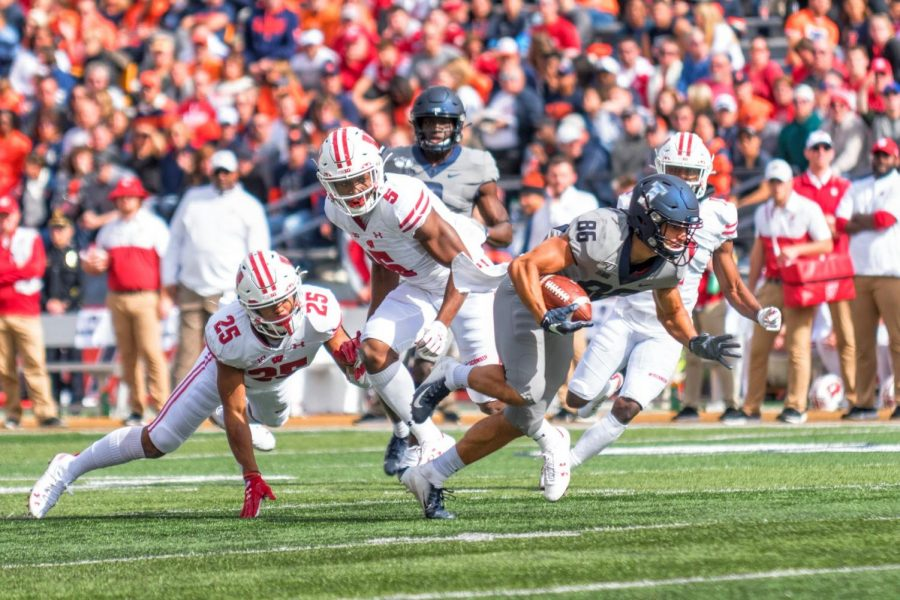 llinois wide receiver Donny Navarro breaks free for a touchdown during the game against Wisconsin. The Illini defeated the Badgers with only four seconds remaining on the clock.