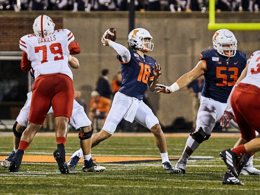 Transfer quarterback Brandon Peters throws a pass during Illinois' game against Nebraska at home Sept. 21..