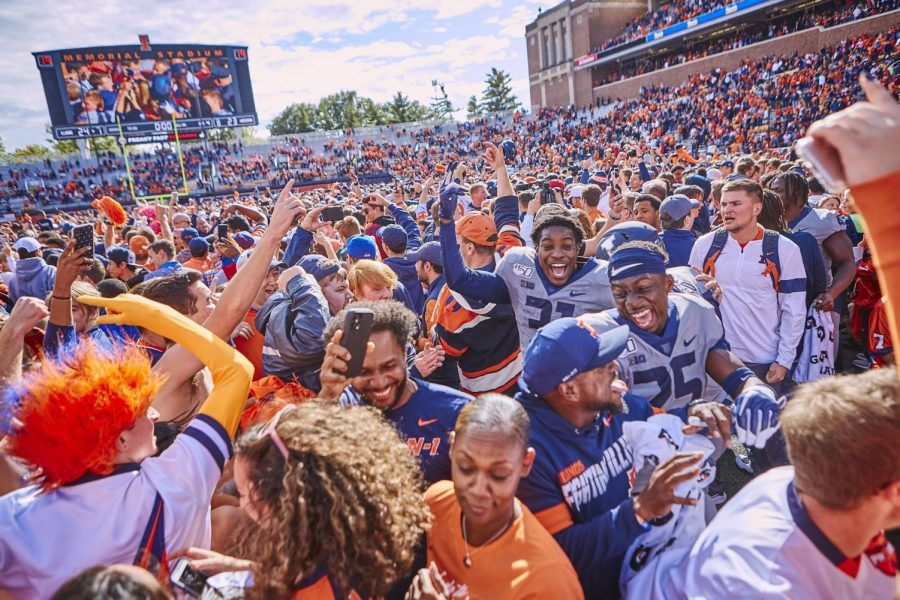 Illinois+celebrates+its+win+against+Wisconsin+on+Saturday.+Soon+after+the+victory%2C+spectators+of+the+game+rushed+the+field.