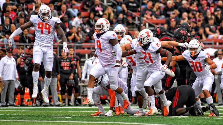 The+Illini+football+team+celebrates+after+a+fourth+down+at+High+Point+Solutions+Stadium+in+New+Jersey+on+Oct.+6%2C+2018.+Illinois+won+38-17%2C+coming+out+of+a+two-game+losing+streak+and+are+playing+Rutgers+this+Saturday.%0A