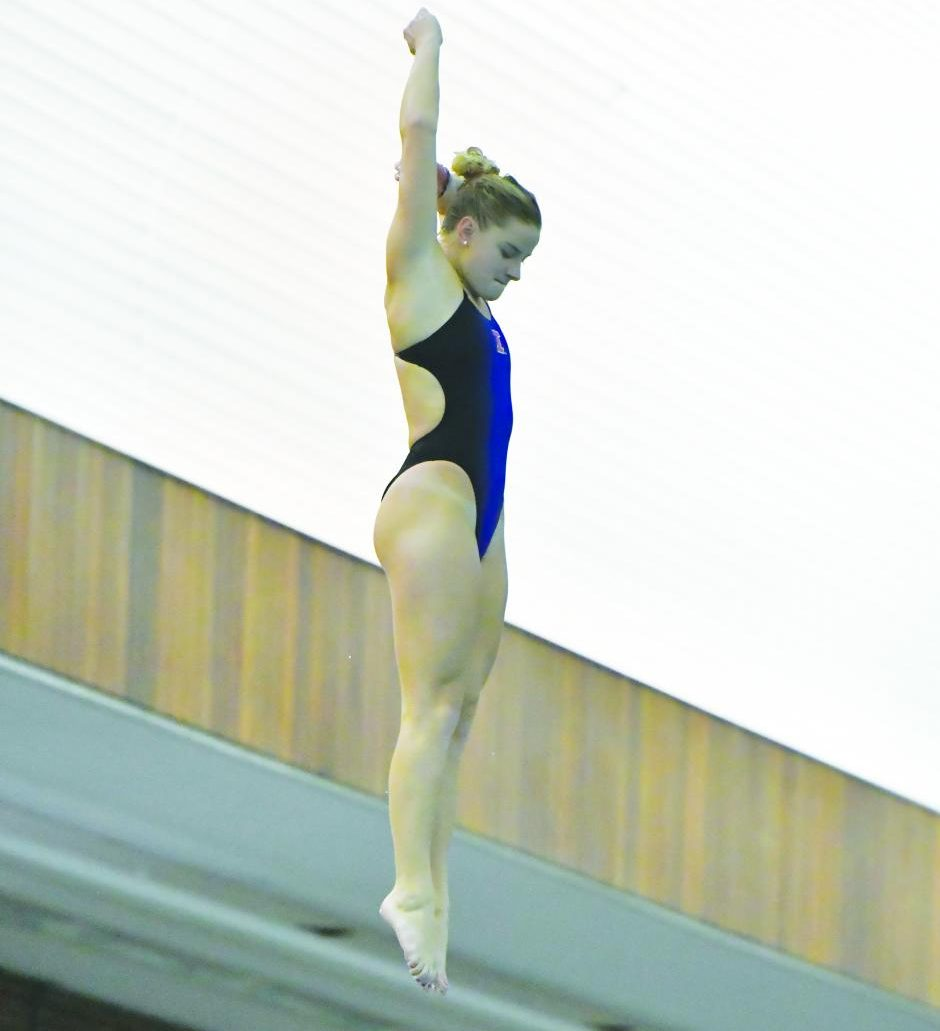 Taylor Shegos dives in a meet against Indiana State at the ARC on Friday. Shegos broke Illinois' record on the one-meter dive with a score of 299.47.