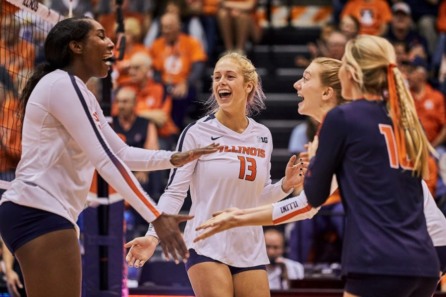 Mica Allison (13) celebrates with her teammates after scoring during Illinois' game against Indiana on Saturday. The Illini swept