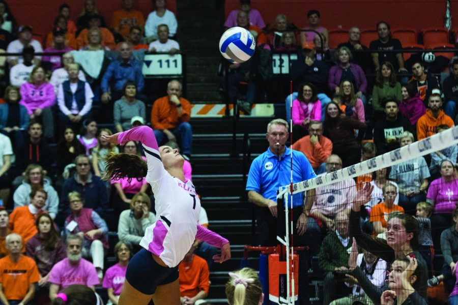 Senior+Jacqueline+Quade+jumps+to+the+net+in+Huff+Hall+on+Saturday.+Quade+led+the+Illini+with+13+kills%2C+helping+the+team+defeat+the+Buckeyes+3-0.