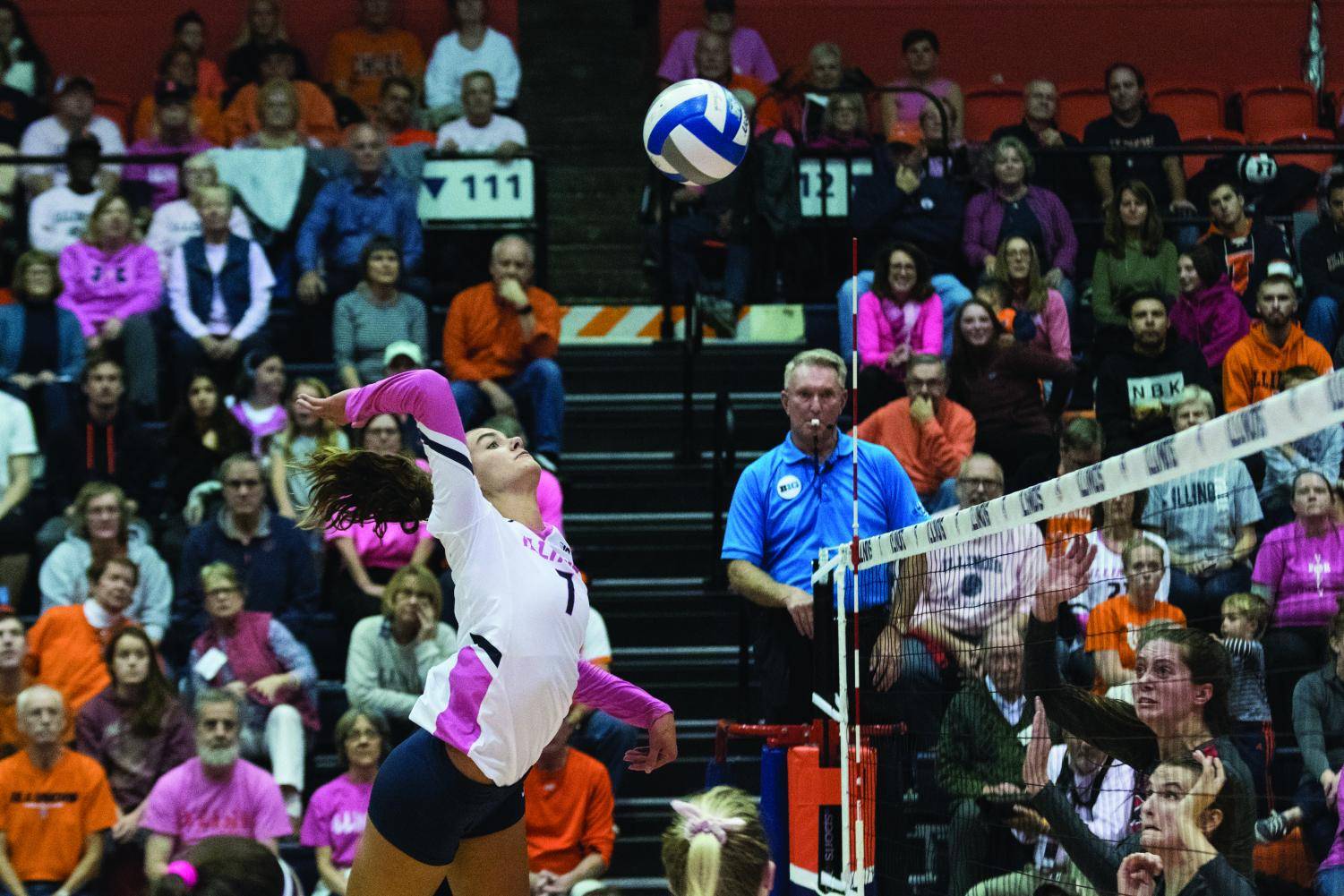 Senior Jacqueline Quade jumps to the net in Huff Hall on Saturday. Quade led the Illini with 13 kills, helping the team defeat the Buckeyes 3-0.