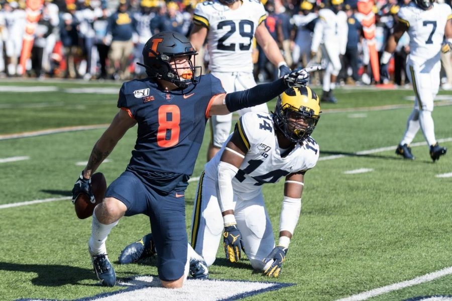 Freshman+wide+receiver+Casey+Washington+celebrates+a+first+down+during+Illinois%E2%80%99+game+against+Michigan+on+Oct.+12.+Washington+was+a+key+contributor+in+Illinois%E2%80%99+upset+over+No.+6-ranked+Wisconsin+Saturday.