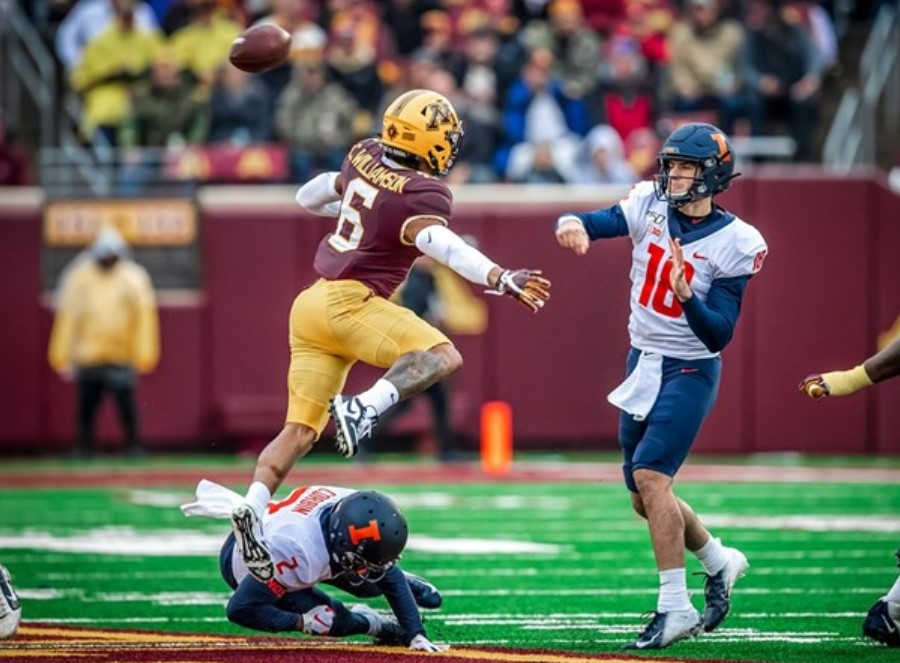 Quarterback Brandon Peters (18) throws a pass during their game vs. Minnesota on Saturday. The Illini will play against Michigan, another Big 10 team, on Oct. 12..