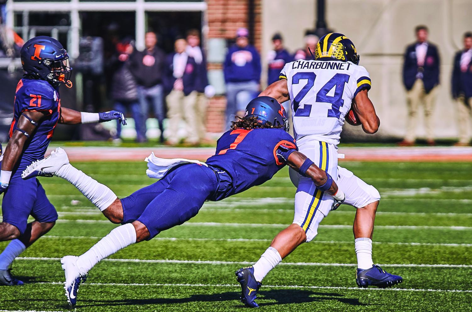 Defensive back Stan Green tackles a Michigan player at Memorial Stadium on Saturday. Despite injury, Green has become an asset to the team in his final season.