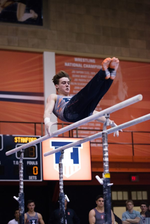 Illinois' Tyson Bull performs a routine on the parallel bars during the meet against Stanford at Huff Hall on Friday, March 6, 2017.