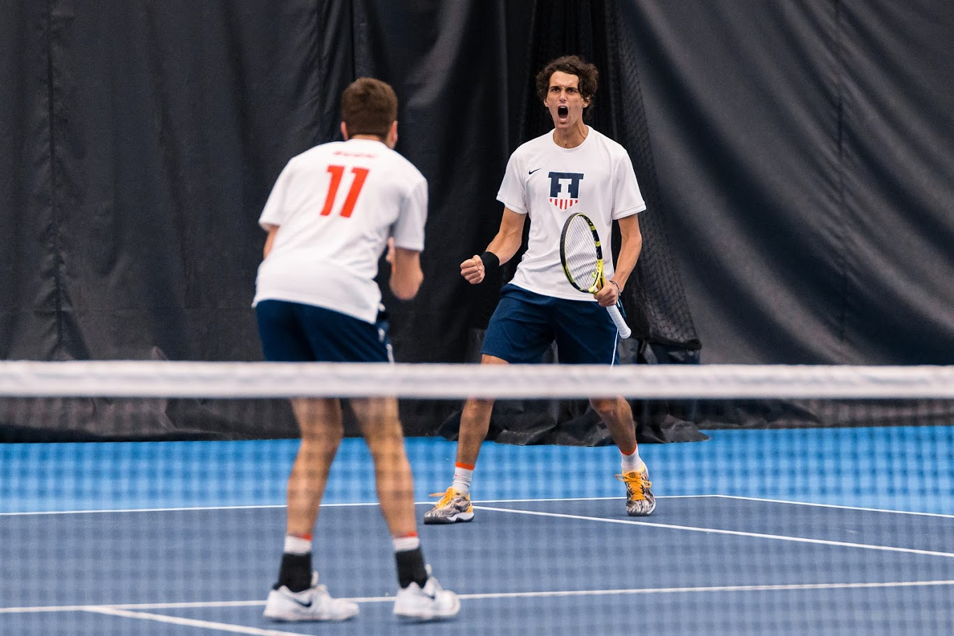 Junior Gui Gomes celebrates with doubles partner senior Vuk Budic. Gomes finished 2-2 in his singles season debut at the Southern Intercollegiate Championships.