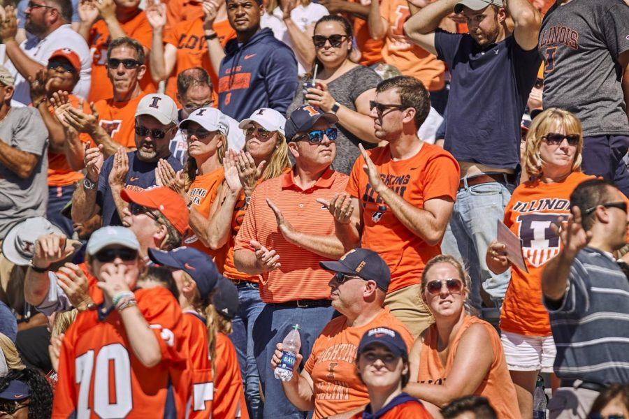 Illinois fans cheer from the stands of Memorial Stadium on Sept. 14 during the Illinois game against Eastern Michigan. Though every student has their own personal perspective of the tradition, Homecoming Week is a celebration that brings the campus together.