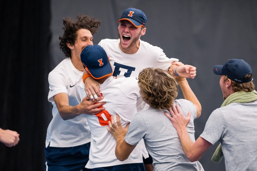 Illinois%27+Zeke+Clark+celebrates+with+his+team+after+winning+his+singles+match+to+end+of+the+match+against+Penn+State+at+Atkins+Tennis+Center+on+Friday%2C+April+12.+The+Illini+won+4-3.