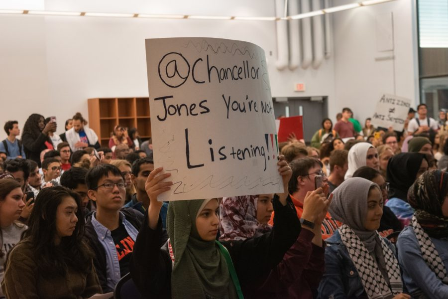 Members of the Students for Justice in Palestine organization (SJP) protest during the Illinois Student Government Meeting at the ARC Multi-Purpose Room on October 23, 2019.