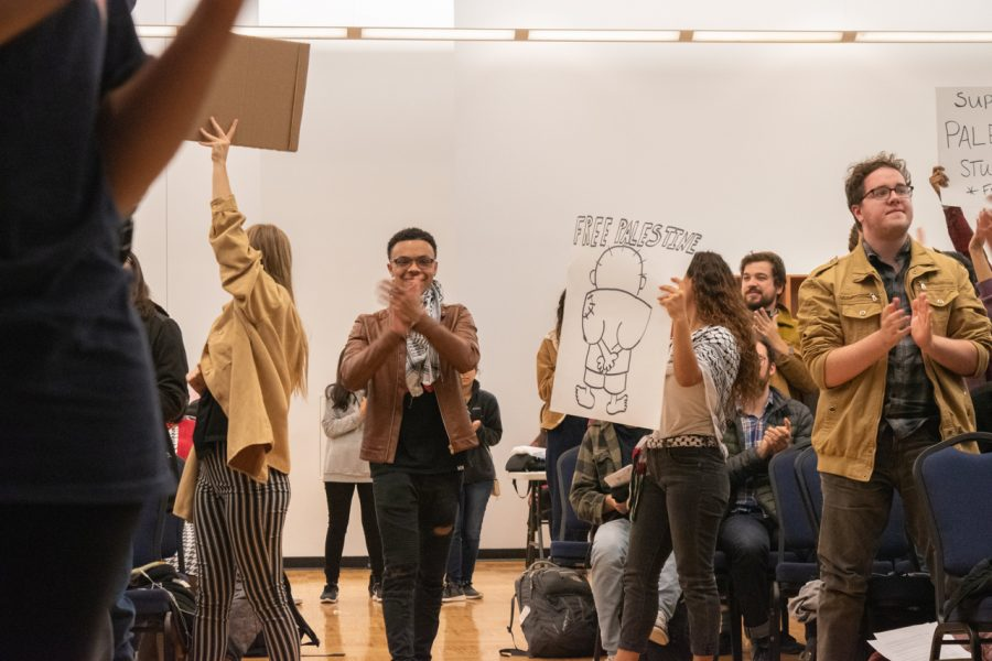 Protestors celebrate after the passing of the resolution.