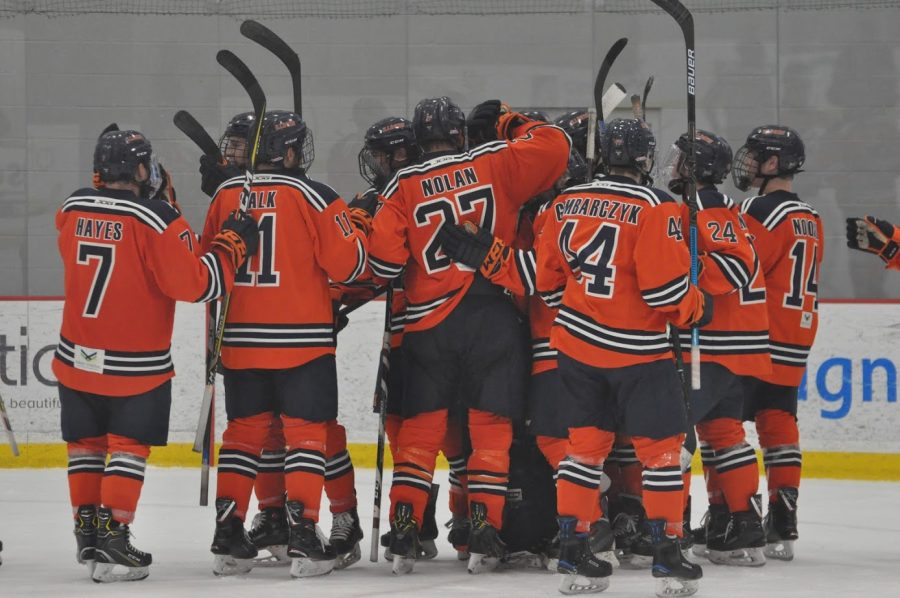 The Illini Hockey team gathers after defeating UNLV 4-1 on Sunday at the Fifth Third Arena.