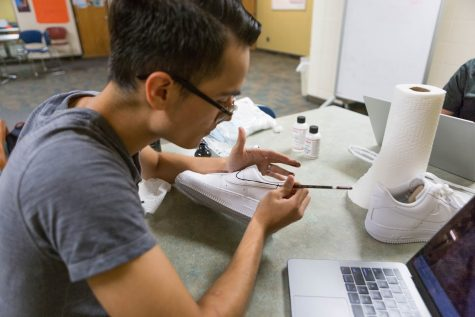 Cedric Vargas is customizing a pair of sneakers that will be available for rental by his company, Teneez, Monday.