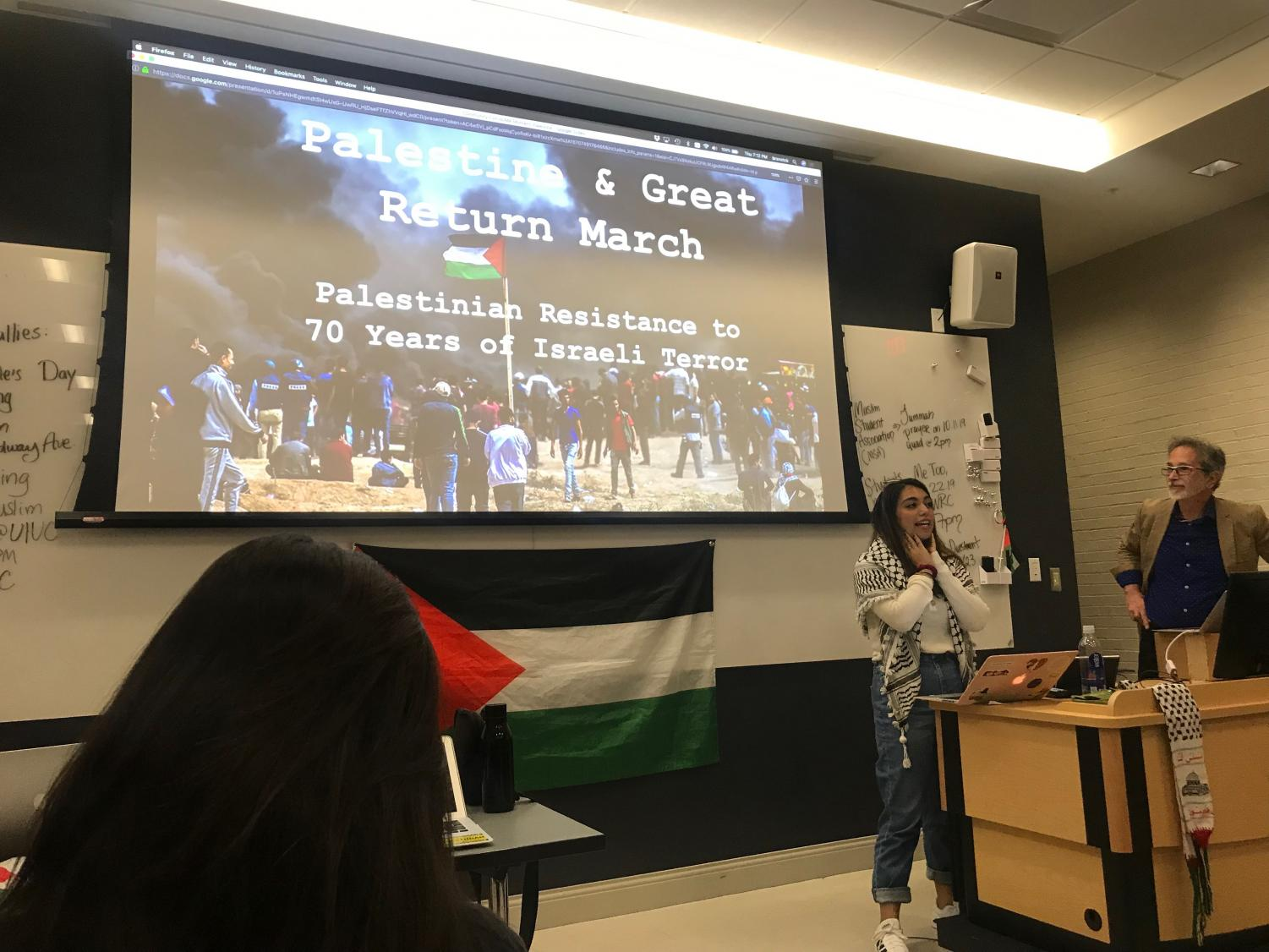 """Students for Justice in Palestine President Ahlam Khatib, left, introduces presenter and religion professor in LAS Bruce Rosenstock during SJP's """"Palestine 101"""" meeting on Oct. 10. Rosenstock pulled up the """"Palestine & Great Return March Palestinian Resistance to 70 Years of Israeli Terror"""" presentation that prompted an apology from Chancellor Robert Jones after concerns of anti-Semitic content during a Sept. 25 Housing staff meeting."""