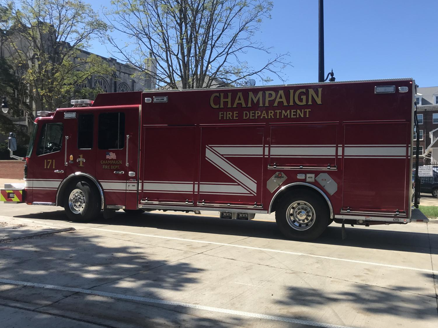 A Champaign Fire Department firetruck leaves the scene on Wright Street around 12:15 p.m. The English Building and Henry Administration Building, both located on Wright Street were evacuated due to a reported gas leak Monday.