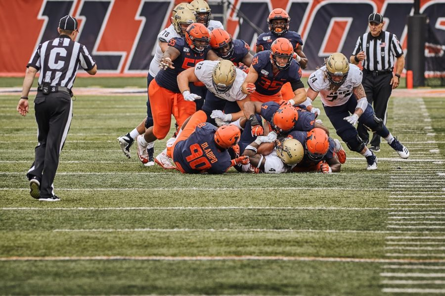 Lere Oladipo is a part of a tackle during the Illini's game versus Akron on Aug 31.