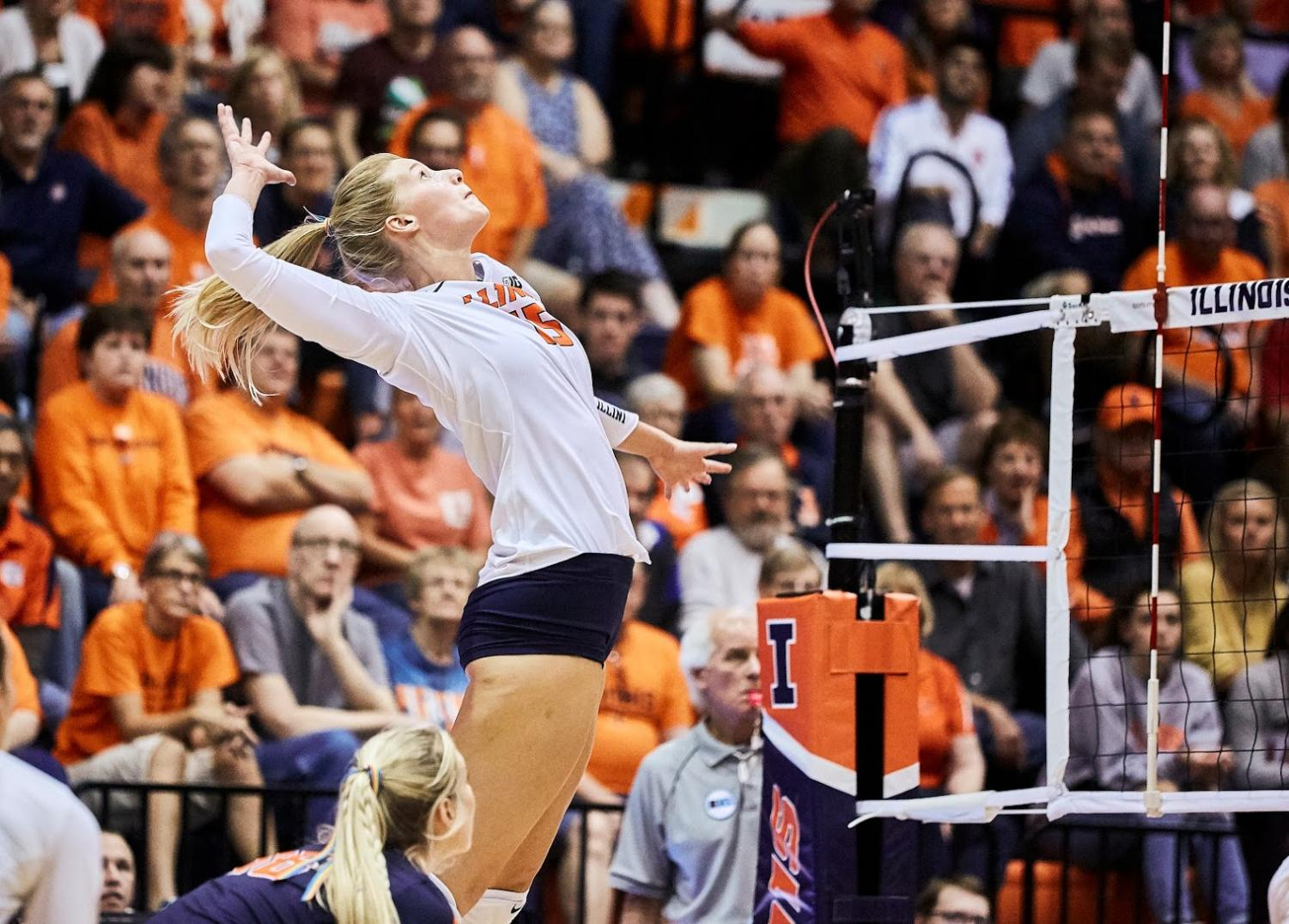 Megan Cooney rises up to spike the ball on Wednesday. The Illini lost 1-3.