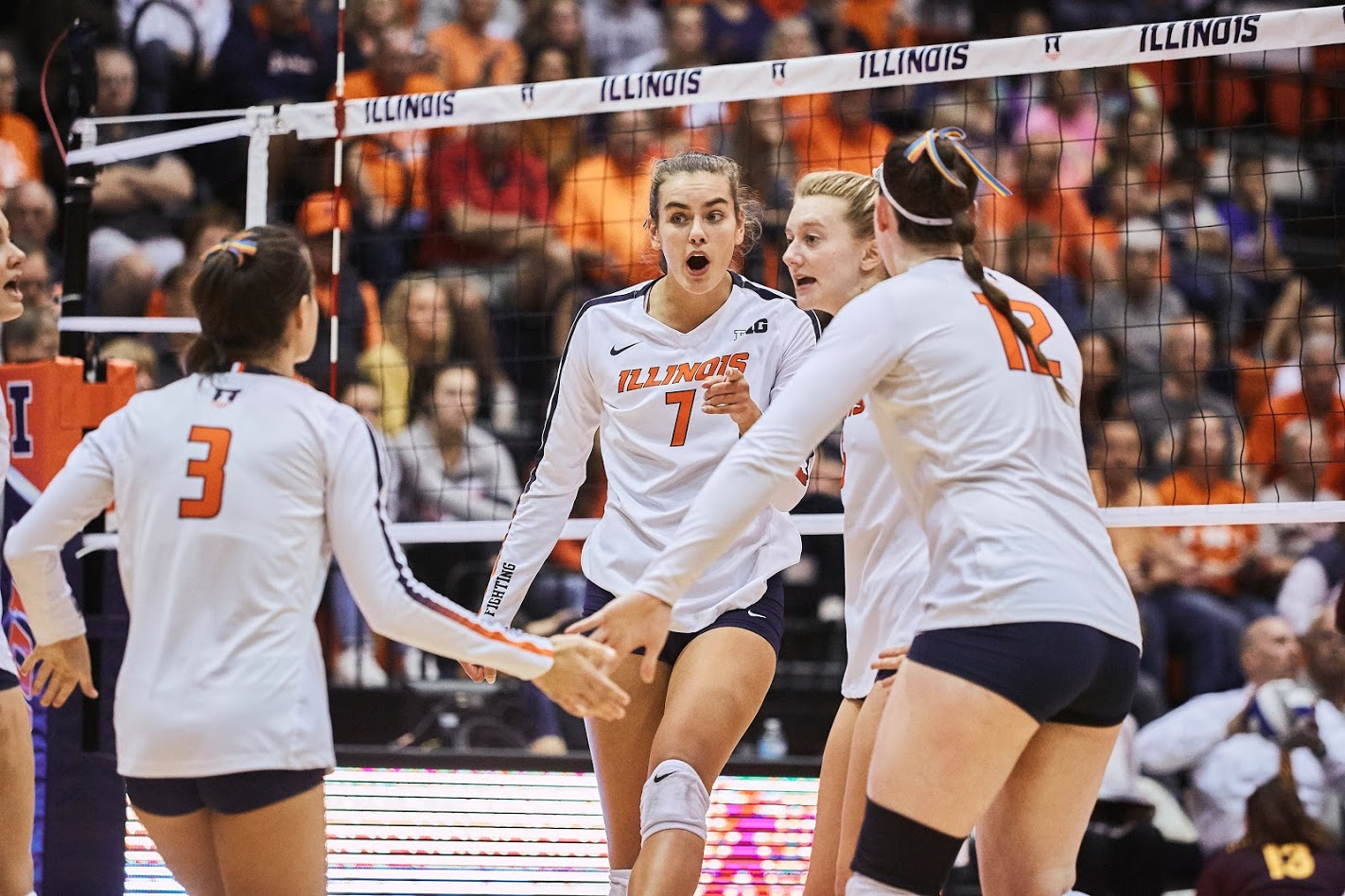 Jacqueline Quade celebrates with the Illini Volleyball team after scoring a point at Huff Hall vs Minnesota on Oct. 9. Illinois lost to Penn State on Wednesday, 3-2.