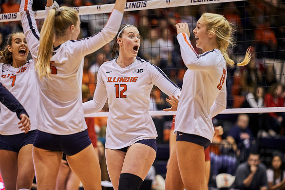 Ashley Fleming (12) celebrates with the Illini Volleyball team after scoring a point at Huff Hall vs. Indiana on Oct. 12.