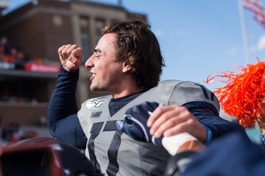 Illinois kicker James McCourt is hoisted into the air by his teammates after the game against Wisconsin.  The Illini won 24-23.