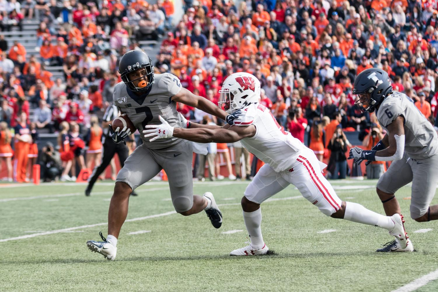 Illinois running back Reggie Corbin stiff arms a defender during the game against Wisconsin.  The Illini won 24-23.