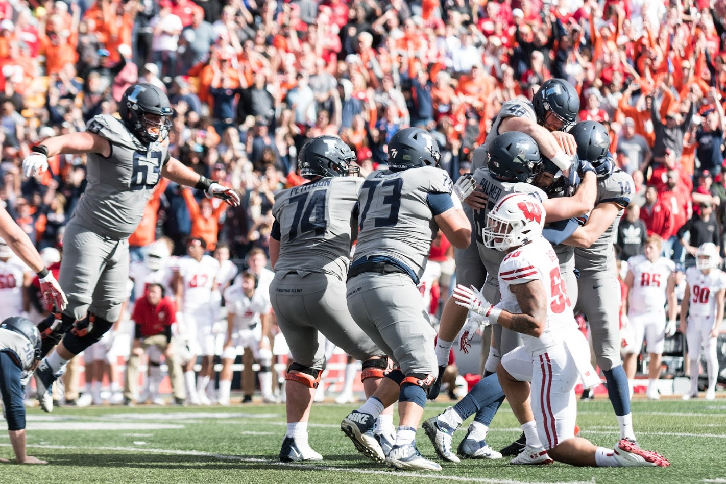 The+Illini+celebrate+the+victory+with+kicker+James+McCourt+during+the+game+against+Wisconsin.++The+Illini+won+24-23.