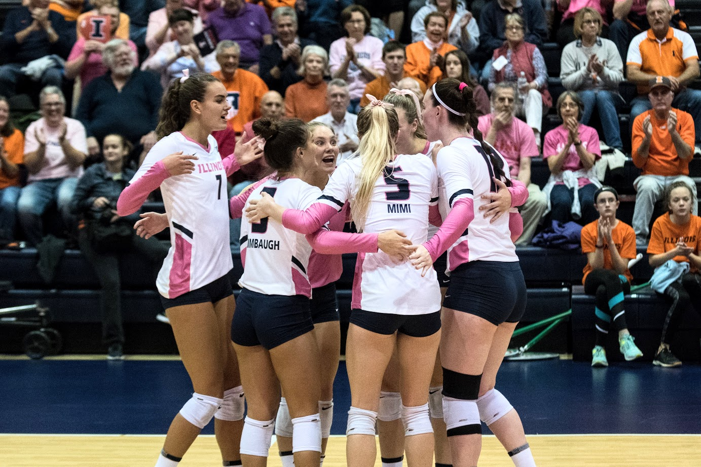 The Illini celebrate after scoring a point vs Ohio State at Huff Hall on Saturday.