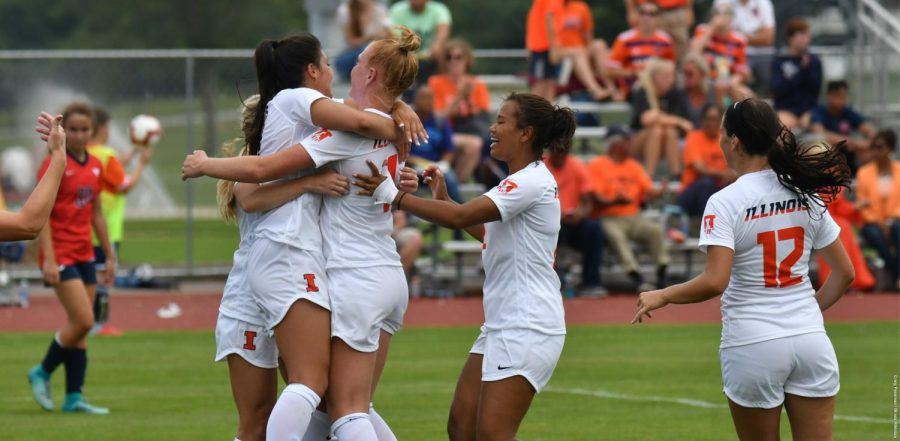 The Illini soccer team celebrate after defeating Minnesota at Demirjian Park on Sunday.