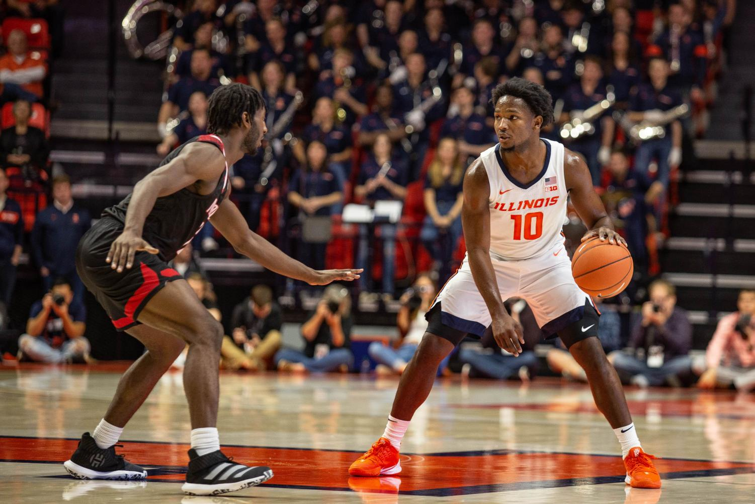 Senior guard Andrés Feliz dribbles in front of Nicholls State's defense during the team's home regular-season opener. The Illini beat the Colonels 78-70 in overtime at the State Farm Center on Nov. 4. Ben Tschetter, The Daily Illini.