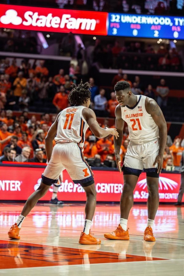 Sophomore+Ayo+Dosunmu+%2811%29+and+freshman+Kofi+Cockburn+%2821%29+prepare+for+Illinois%27+first+regular+season+game+against+Nicholls+State+at+State+Farm+Center+on+Nov.+5%2C+2019.+The+Illini+lost+to+the+Arizona+Wildcats+in+their+first+road+swing+of+the+season+90-69+Sunday+night.+