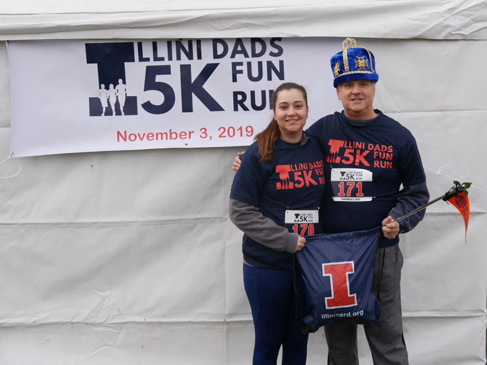 Jim Jones poses with his daughter at the Illini Dads 5k on Sunday.