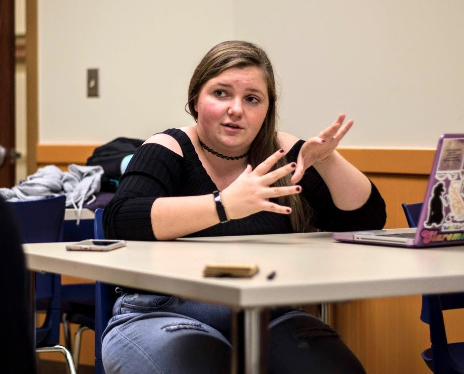 Sarah Gale, junior in ACES, speaks at the School of Social Work about her personal experiences with the California Wildfires. Her family had to evacuate their home due to a fire in 2003.
