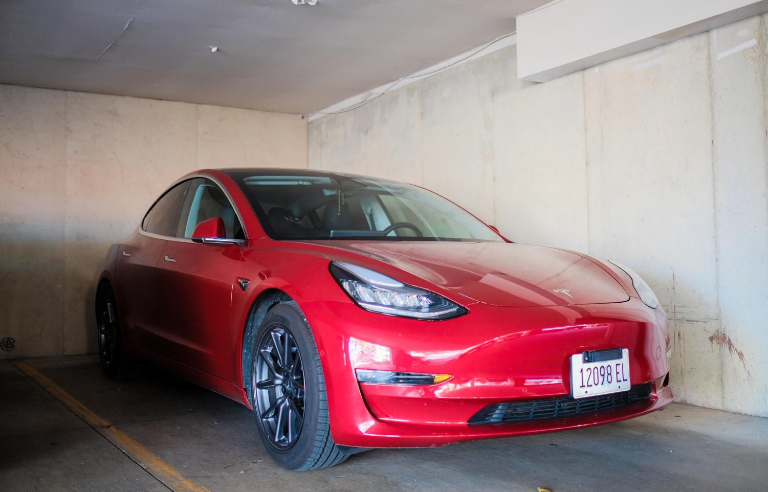 A Tesla Model 3 sits in a parking lot in Urbana. Researchers at the University are trying to improve the safety of self-driving cars.