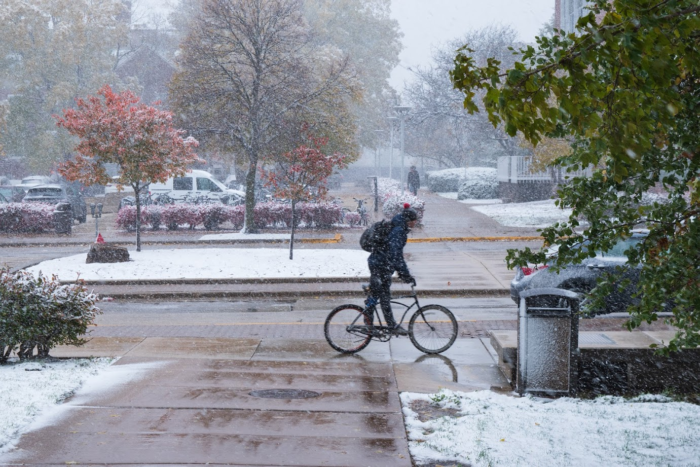 Brigida dockus The Daily Illini A bike rides along a sidewalk in Champaign on Oct. 31. The Urbana City Council has made efforts to increase the areas where they enforce snow plowing; however, the group has been criticized by the community for not making the operation mandatory citywide.