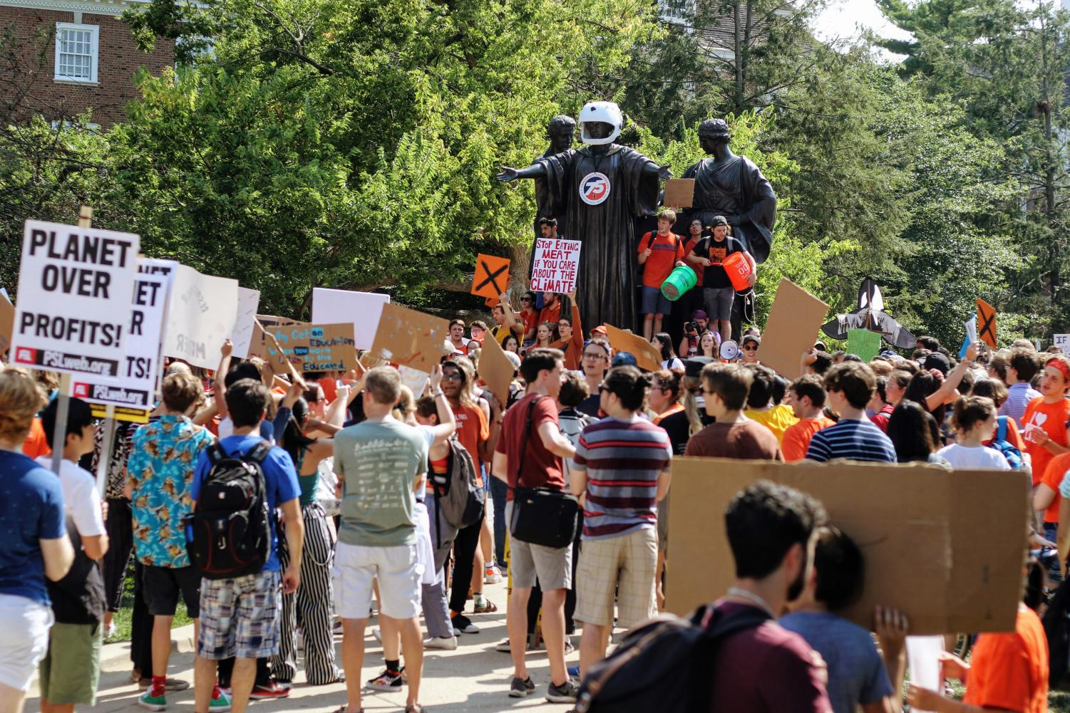 Students congregate while members of the Young Democratic Socialists of America protest during the Earth Strike in front of Alma Mater on Sept. 20. RSOs are working together to encourage students to explore their options before the next election.