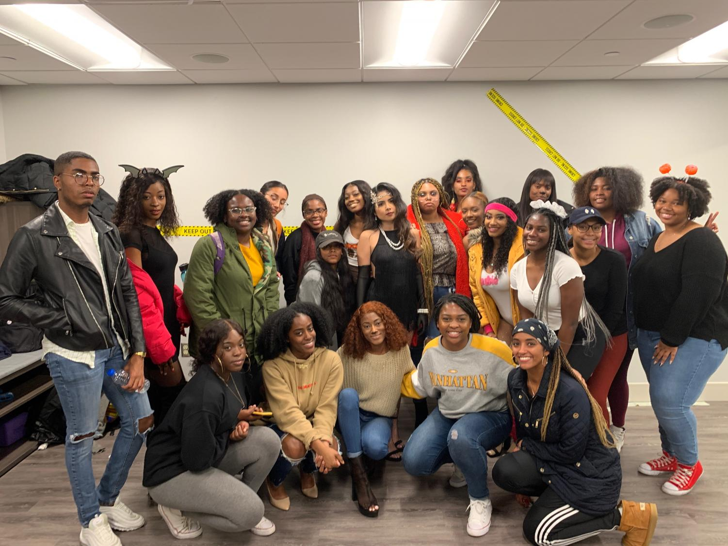 Two student RSOs, The Kat Walk and Living in Color, pose for a photo at the Bruce D. Nesbitt African American Cultural Center on Oct. 30.  The Kat Walk's debut fashion show will take place in the spring.
