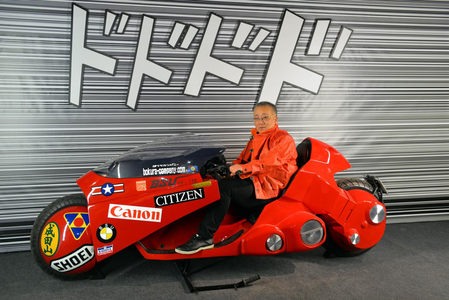 """Katsuhiro Otomo riding Kaneda's motorcycle at Angoulême International Comics Festival on Jan. 27, 2016. Columnist Dylan recognizes the film """"Akira"""" predicted many of the political, social and economic issues in 2019."""