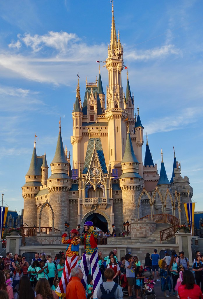 Cinderella's Castle stands tall at Disney World. Columnist Tommy draws attention to Disney's money-making strategies and urges viewers to recognize its cheapness.