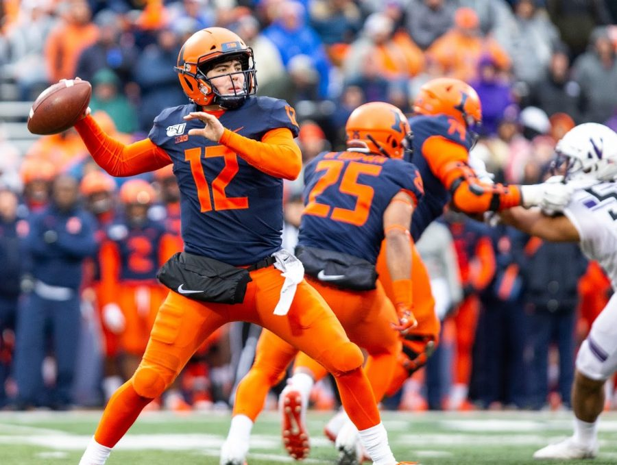 Quarterback+Matt+Robinson+%2812%29+attempts+to+throw+a+pass+during+Illinois%E2%80%99+final+regular-season+game+against+Northwestern+at+Memorial+Stadium.+The+Illini+failed+to+gain+offensive+momentum+and+fell+to+the+Wildcats+29-10+on+Saturday.