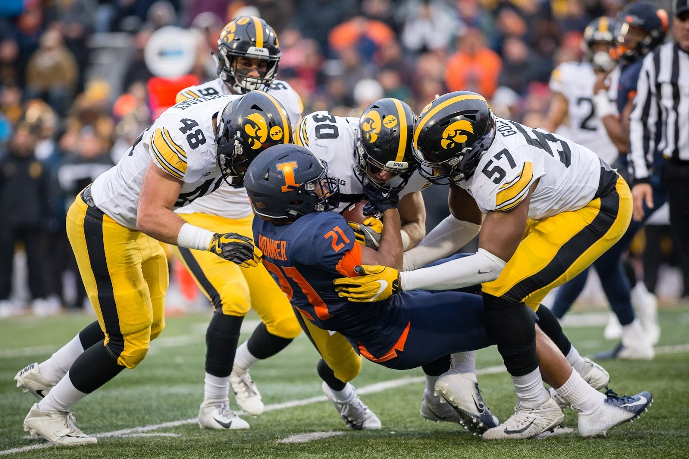 Illinois running back Ra'Von Bonner is tackled during Illinois' game against Iowa at Memorial Stadium on Nov. 17, 2018. The Illini will face the Hawkeyes Saturday after their 63-0 loss last year.
