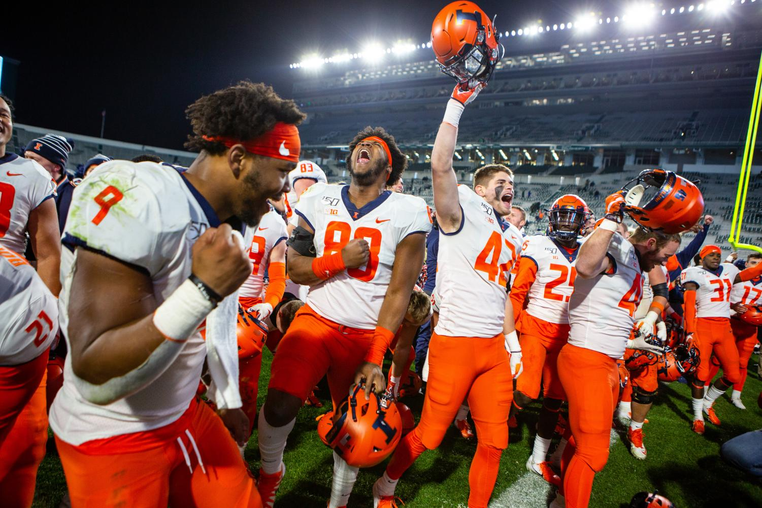 The Illini Football team erupt in celebration after defeating the Michigan State Spartans on Saturday. The Illini won 37-34.
