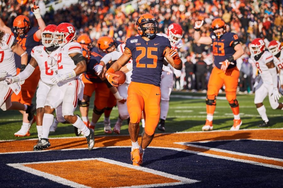Running+back+Dre+Brown+crosses+the+goal+line+for+a+touchdown+during+the+Illini%E2%80%99s+game+against+the+Scarlet+Knights+at+Memorial+Stadium+Saturday.+The+Illini+rushed+for+204+total+yards+and+won+38-10.