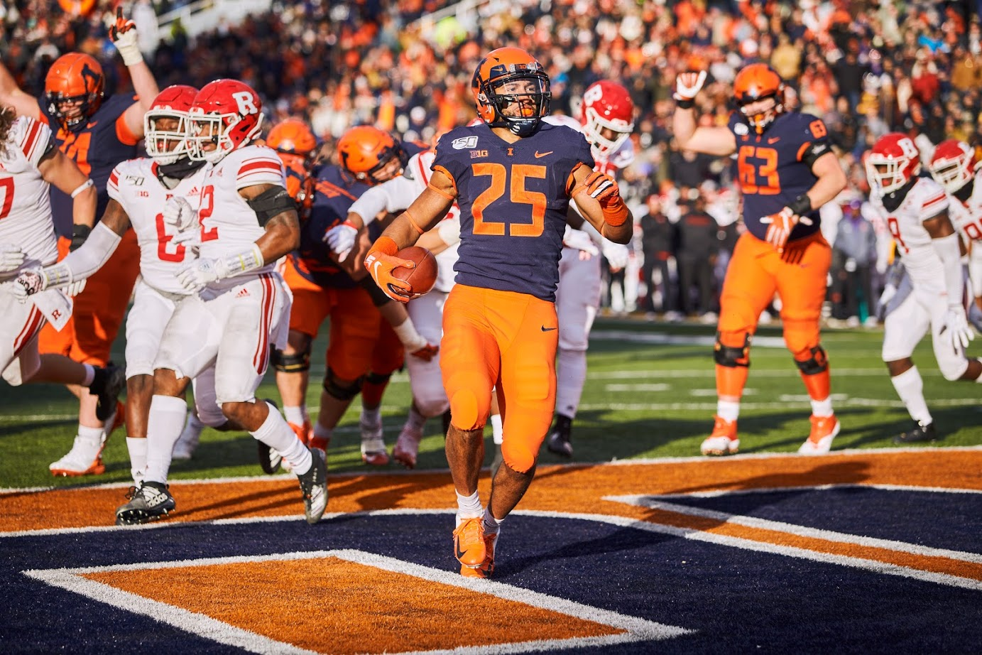 Running back Dre Brown crosses the goal line for a touchdown during the Illini's game against the Scarlet Knights at Memorial Stadium Saturday. The Illini rushed for 204 total yards and won 38-10.
