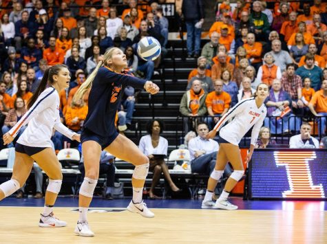 Morgan O' Brien (middle) sets up Jacqueline Quade (left) for a spike during Illinois' game against No. 8 Penn State at Huff Hall on Friday. The Illinois volleyball team will play at Maryland on Friday and Ohio State on Sunday.