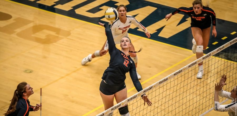 Ashlyn Fleming spikes the ball during the Illini's game versus the Wolverines at the Cliff Keen Arena on Saturday. The Illini lost 3-1.