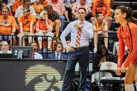 Coach Tamas gazes at the court at Huff Hall on on Sept. 28.
