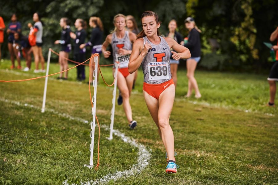 Rebecca Craddock runs at the Illini Open at the UI Arboretum on Aug. 30.